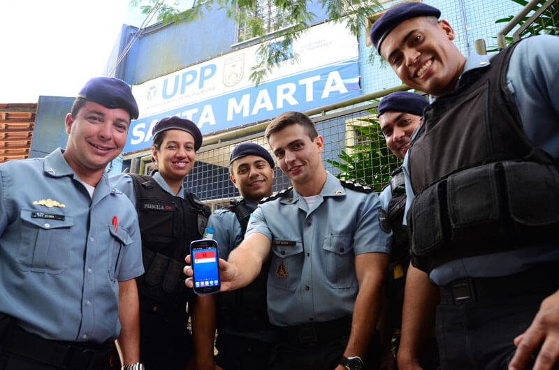 Brazilian police officers showing CopCast app